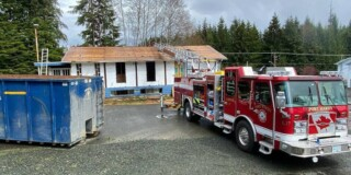 A fire truck sits outside an old building